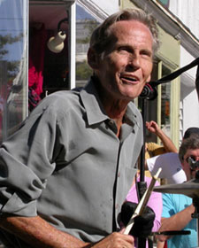 Levon Helm performing in 2004 on the Village Green in Woodstock, New York. Photo by Jaime Martorano.