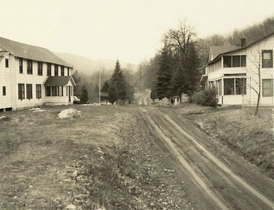 Smitty's Bar and Dude Ranch as they appeared in the 1950s. Clove Valley Road was not paved at the time. The structure to the left is the bar and hotel, an old barn now renovated into the home of Pardini and Fink. The structure to the right was Wilbur Smith's home.
