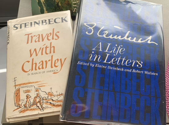 Collectors' editions of two of Steinbeck books, including a copy of A Life in Letters signed by Elaine Steinbeck, his last wife and editor of the project. Photo by Eric Francis.