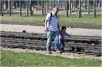 Child and dad walk back toward the main gait of Birkenau on Sept. 27, 02006. Photo by Eric Francis.