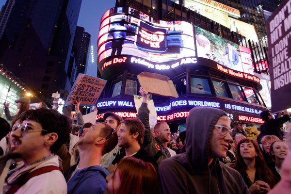 Breaking story -- ABC News ticker informs protesters at Times Square in New York City on Saturday, Oct. 15 that the #Occupy movement has gone global. Photo by Eric Francis.