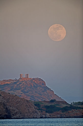 Scorpio Full Moon rising over Sounion, the temple of Poseidon. Photo by Anthony Ayiomamitis.