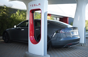 A Model S at a Supercharger station; photo by Tesla Motors.
